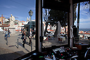 View from the inside of a Lisbon's nº28 yellow tram at  Portas do Sol square, on his way to Graça district. At the right we can see a spectacular view towards the river Tagus river.