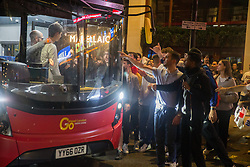 © Licensed to London News Pictures.  12/07/2021. London, UK. Italian football fans stopped the bus in central London as England lose to Italy on penalties during the EURO 2020. Photo credit: Marcin Nowak/LNP