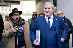 © Licensed to London News Pictures. 17/11/2019. London, UK. The Scottish National Party's Westminster Leader Ian Blackford talks to Anti Corbyn protesters as he leaves the BBC after appearing on The Andrew Marr Show. Photo credit: George Cracknell Wright/LNP