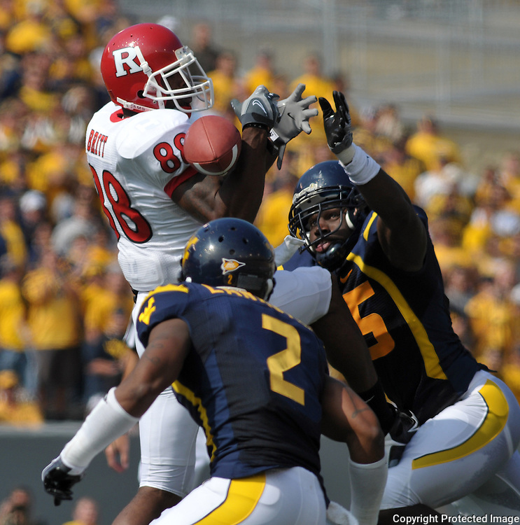 Oct 4, 2008; Morgantown, WV, USA; A pass to Rutgers wide receiver Kenny Britt is broken up by West Virginia's defensive back Ellis Lankster (2) and Derek Knight (35) during the third quarter of West Virginia's 24-17 victory over Rutgers.