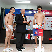 Istanbulls Mehmet TOPCAKAN (L) and Kremlin Bears boxers Alisher MAHMUDOV (R) seen during their Presentation and the weighing ceremony matchday 4 of the World Series of Boxing at Ahmet Comert Arena in Istanbul, Turkey, Thursday, January 13, 2011. Photo by TURKPIX