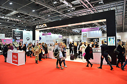 © Licensed to London News Pictures. 28/03/2016. Visitors walk past stands at The Professional Beauty Show. The show is the largest in the UK and one of the largest in Europe. London, UK. Photo credit: Ray Tang/LNP