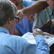 Hall of Fame inductee Freddie Roach signs autographs during the 23rd Annual Induction citywide parade at the International Boxing Hall of Fame on Sunday, June 10, 2012 in Canastota, NY. (AP Photo/Alex Menendez)