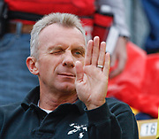 Joe Montana, former Notre Dame quarterback and NFL legend, sizes up the crowd before the annual Blue-Gold Spring Game at Notre Dame Stadium.  Montana's son Nate had an impressive day at quarterback for the Gold team.