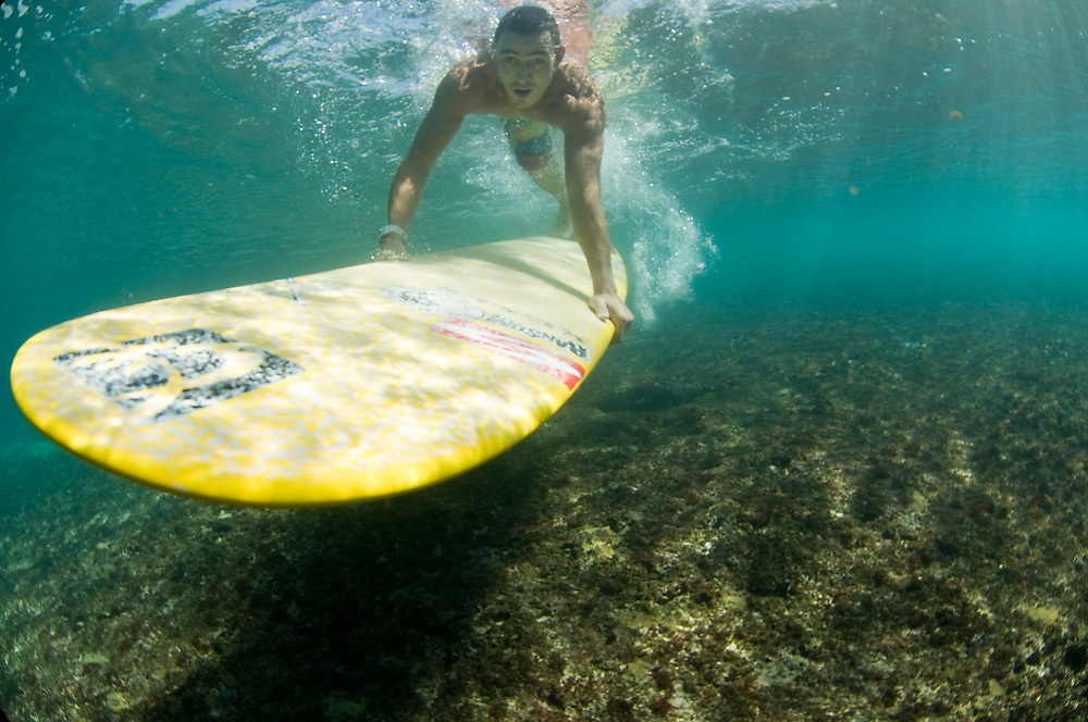 November 9th  2010: Dane Pioli duck diving a wave at Rocky Point on the North Shore of Oahu-Hawaii. Photo by Matt Roberts/mattrIMAGES.com.au