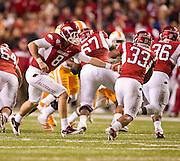 Nov 12, 2011; Fayetteville, AR, USA;  Arkansas Razorbacks quarterback Tyler Wilson (8) hands the ball to runningback Dennis Johnson (33) during a game at Donald W. Reynolds Razorback Stadium. Arkansas defeated Tennessee 49-7. Mandatory Credit: Beth Hall-US PRESSWIRE