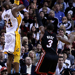March 10, 2011; Miami, FL, USA; Los Angeles Lakers shooting guard Kobe Bryant (24) shoots over Miami Heat shooting guard Dwyane Wade (3) during the fourth quarter at the American Airlines Arena. The Heat defeated the Lakers 94-88.    Mandatory Credit: Derick E. Hingle