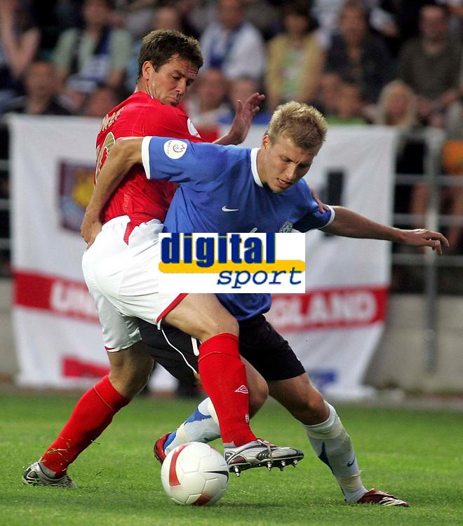 Photo: Paul Thomas.<br /> Estonia v England. UEFA European Championships Qualifying, Group E. 06/06/2007.<br /> <br /> Michael Owen (L) of England battles with Ragnar Klavan.