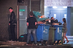 © Licensed to London News Pictures . 30/10/2016 . Manchester , UK . Men urinate against wheelie bins on Well Street . Revellers on a night out , many in fancy dress , on the weekend before Halloween . Photo credit : Joel Goodman/LNP