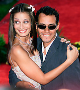 Latin music star Marc Anthony (R) poses with his wife Dayanara Torres (L) prior to the 2002 Latin Billboard Awards show taping in Miami Beach, Florida May 9, 2002. The event, which showcases the music industry's hotest latin music stars, will air on the Telemundo network, May 12, 2002. Colin Braley/Stock