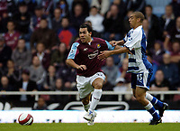 Photo: Olly Greenwood.<br />West Ham United v Reading. The Barclays Premiership. 01/10/2006. West Ham's Carlos Teves and Reading's James HARPER