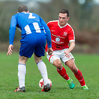 Newmarket Celtic's David Reidy gets past Turnpike Rover's Colin Smyth