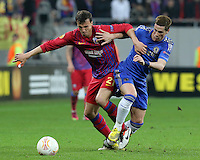 Chelsea's Fernando Torres (R) vies with Steaua Bucharest's Vlad Chiriches (L) during the first leg of the UEFA Europa League round of 16 football match between Steaua Bucharest and Chelsea at the National Arena Stadium in Bucharest on March 7, 2013.
