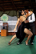 Argentinian couple doing a tango dance perfromance, on a traditional estancia, Lujan, Argentina.