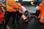 Security try to prevent climate protectors to lock-on at the gates to Quadrilla drill site July 4th 2017, Kirkham, Lancshire, United Kingdom.One activists was restrained by the site manager using pressure points to the neck and throat and held to the ground by three security staff on the main road outside Quadrillas property. Two activists managed to lock themselves down and block the gates.  A lock-on, where two or more lock themselves together inside a re-inforced tube is used as a peaceful non-violent way of blocking the gates to the site.The New Preston Road Quadrilla site is almost ready to start drilling for shale gas after many delays caused by local objections. Lancashire County council voted against fracking but the conservative central government forced it through.