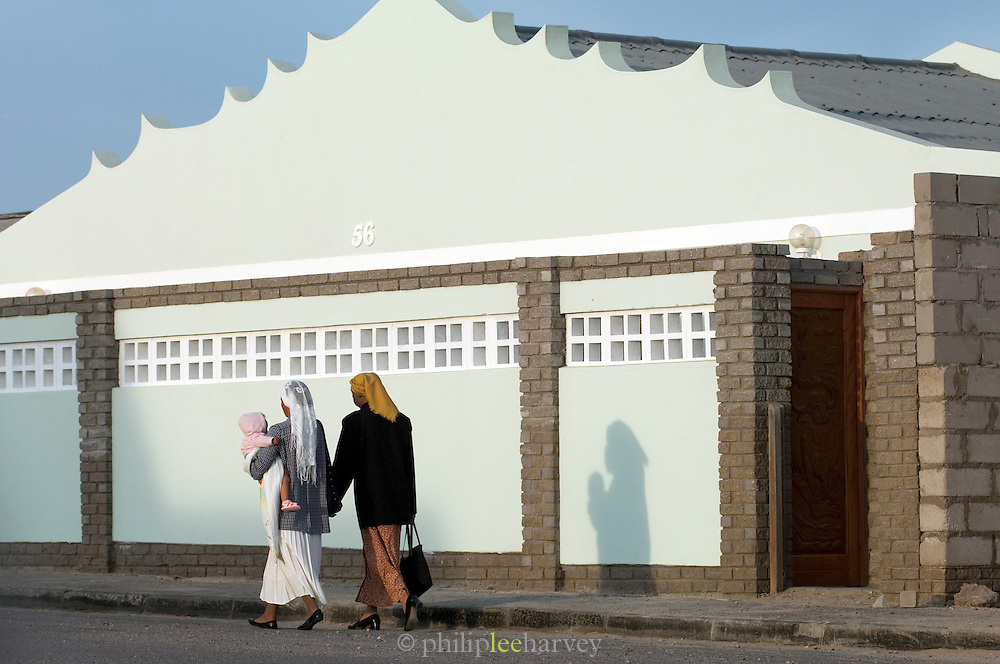Women with a child walk down a street in Namibia