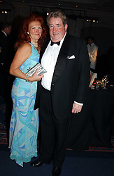 SIR WILLIAM & LADY MCALPINE at the 2004 Cartier Racing Awards in association with the Daily Telegraph, held at the Four Seasons Hotel, London on 17th November 2004.<br />