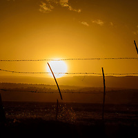 010414  Adron Gardner/Independent<br /> <br /> A dusty horizon scatters orange light at sunset in Bluewater Village Saturday.  Grants area winds climbed to nearly 30 mph Saturday.