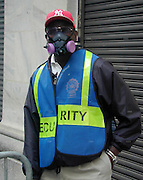 "A police officer outside the NYSE wears a protective asbestos mask three days after the attacks on the World Trade Center. Through my eyes and with my camera I am able to see the world we live in, and try to bring things into focus. Photography preserves my vision of what ""I see"" at a specific time and place- a moment. Creating a bond between  me and my subject and capturing and emotion for eternity. Having lived and worked in New York City for over 15 years when 911 happened. I had to go and ""see"" with my camera what lower Manhattan was like after this horrific attack on our Nation. The World Trade Center owned the skyline in lower Manhattan making it feel more like a canyon. After the Twin Towers fell, and I saw with my own eyes and camera the destruction, I realized what little land they actually sat on. The Twin Towers may not have occupied a large plot of land but they now touched everyones life. Photo©SuziAltman"