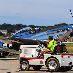 Lancaster, PA, USA - August 22, 2015: Event staff drives a tractor at the Community Days at the Lancaster Airport.