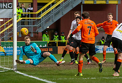 Partick Thistle's keeper Scott Fox saves from Dundee United's Paul McMullan. Dundee United 1 v 1 Partick Thistle, Scottish Championship game played 7/3/2020 at Dundee United's stadium Tannadice Park.