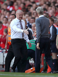 Burnley manager Sean Dyche (left) and Arsenal manager Arsene Wenger shake hands after the Premier League match at the Emirates Stadium, London.