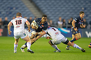 Viliame Mata (#8) of Edinburgh Rugby runs at Ross Kane (#18) and Eric O'Sullivan (#1) of Ulster Rugby during the Guinness Pro 14 2018_19 match between Edinburgh Rugby and Ulster Rugby at the BT Murrayfield Stadium, Edinburgh, Scotland on 12 April 2019.