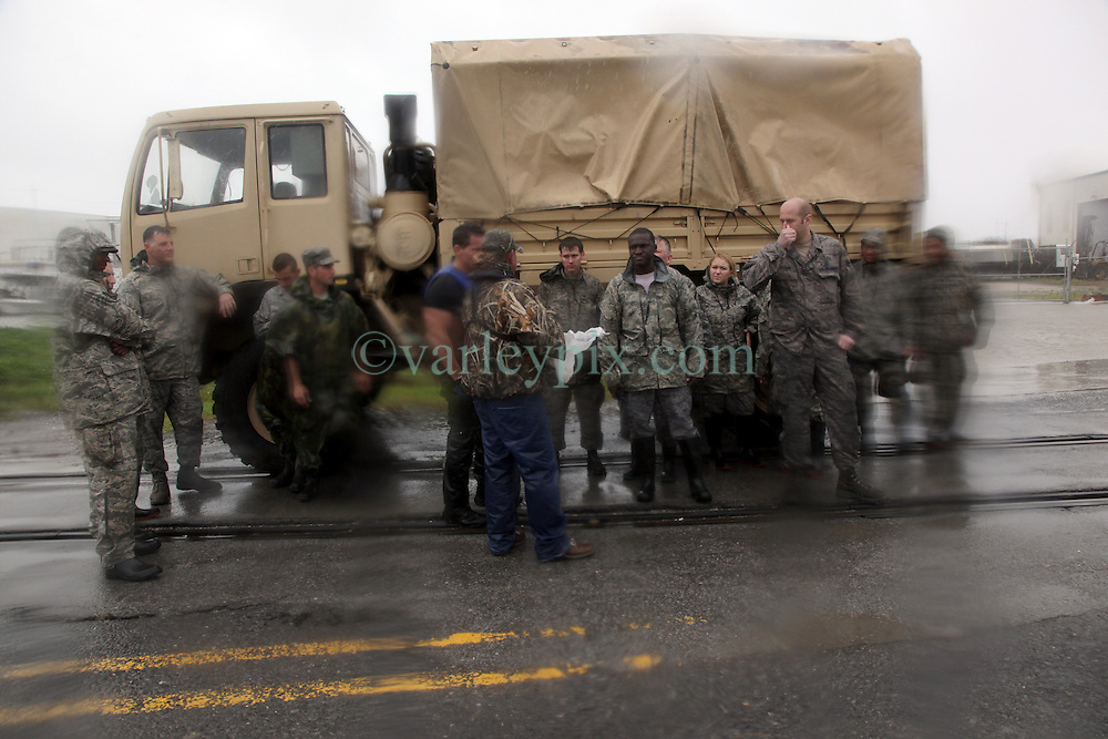 29 August 2012. Braithwaite, Plaquemines Parish, Louisiana,  USA. <br /> Members of the Air National Guard await orders as they assist with emergency evacuations. Hurricane Isaac batters the community of Braithwaite in Plaquemines Parish where residents were evacuated following the overtopping of a  levee. The water gushed in, inundating peoples houses on the 7th year anniversary of Hurricane Katrina.<br /> Photo; Charlie Varley/varleypix.com