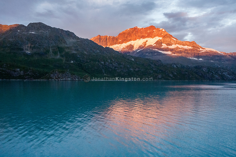 Mount Cooper catches the first rays of sunlight at dawn, Glacier Bay National Park, Alaska.