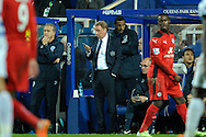 Queens Park Rangers manager Harry Redknapp on his phone during the second half as QPR player Rio Ferdinand looks on behind him. . Barclays Premier league match, Queens Park Rangers v Leicester city at Loftus Road in London on Saturday 29th November 2014.<br /> pic by John Patrick Fletcher, Andrew Orchard sports photography.