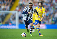 West Bromwich Albion's Morgan Amalfitano is watched by Arsenal's Tomas Rosicky<br /> <br /> Photo by Stephen White/CameraSport<br /> <br /> Football - Barclays Premiership - West Bromwich albion v Arsenal - Sunday 6th October 2013 - The Hawthorns - West Bromwich<br /> <br /> © CameraSport - 43 Linden Ave. Countesthorpe. Leicester. England. LE8 5PG - Tel: +44 (0) 116 277 4147 - admin@camerasport.com - www.camerasport.com