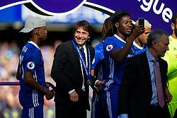 Chelsea manager Antonio Conte looks on from the winners podium as Chelsea celebrate winning the 2016/17 Premier League - Rogan Thomson/JMP - 21/05/2017 - FOOTBALL - Stamford Bridge - London, England - Chelsea v Sunderland - Premier League..