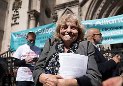 © Licensed to London News Pictures. 23/04/2021. London, UK. Former Post Office sub-postmaster Jo Hamilton reacts to the verdict outside The High Court. The Appeal Court has cleared the names of a group of 42 sub-postmasters - some of whom were jailed for stealing money after the Horizon accounting software was installed at Post Offices. At a previous High Court hearing a judge found the Fujitsu accounting system had major faults and defects. The Post Office has already agreed to pay £58m in a settlement with more than 500 sub-postmasters. <br /> Six convictions were overturned last year . Photo credit: Peter Macdiarmid/LNP
