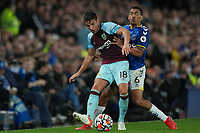 Football - 2021 / 2021 Premier League - Everton vs Burnley - Goodison Park - Monday 13th September 2021<br /> <br /> <br /> Burnley's Ashley Westwood under pressure from Everton's Allan <br /> <br /> <br /> <br /> Credit COLORSPORT/Terry Donnelly