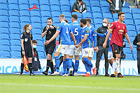 Football - 2020 / 2021 Premier League - Brighton and Hove Albion vs. Manchester United<br /> <br /> Referee Mr Chris Kavanagh points to the spot after awarding Manchester United a late penalty after he'd blown full time at The Amex Stadium Brighton <br /> <br /> COLORSPORT/SHAUN BOGGUST
