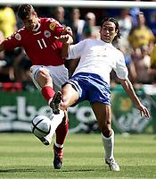 ◊Copyright:<br />GEPA pictures<br />◊Photographer:<br />Dominic Ebenbichler<br />◊Name:<br />Nesta<br />◊Rubric:<br />Sport<br />◊Type:<br />Fussball<br />◊Event:<br />Euro 2004, Europameisterschaft, EM, Italien vs Daenemark, ITA vs DEN<br />◊Site:<br />Guimaraes, Portugal<br />◊Date:<br />13/06/04<br />◊Description:<br />Ebbe Sand (DEN), Alessandro Nesta  (ITA)<br />◊Archive:<br />DCSDE-130604716<br />◊RegDate:<br />14.06.2004<br />◊Note:<br />9 MB - KA/KA - Gemaess UEFA keine Nutzungsrechte fuer Mobiltelefone, PDAs und MMS-Dienste - no MOBILE - no PDAs - no MMS