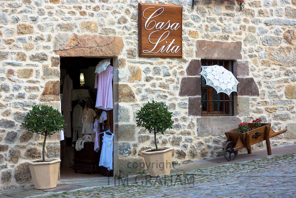 Clothing gifts and souvenirs in Casa Lita shop in Calle Del Racial in Santillana del Mar, Cantabria, Northern Spain