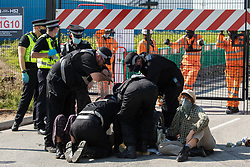 A Hertfordshire Police cutting team works to remove two environmental activists from HS2 Rebellion who used a lock-on arm tube to block a gate to the South Portal site for the HS2 high-speed rail link on 14 September 2020 in West Hyde, United Kingdom. Anti-HS2 activists blocked two gates to the same works site for the controversial £106bn rail link, one remaining closed for over six hours and another for over nineteen hours.