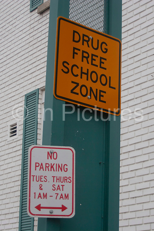 A street sign announces a Drug Free School Zone in Minot, North Dakota, United States. In creasing drug use amongst minors calls for such measures.