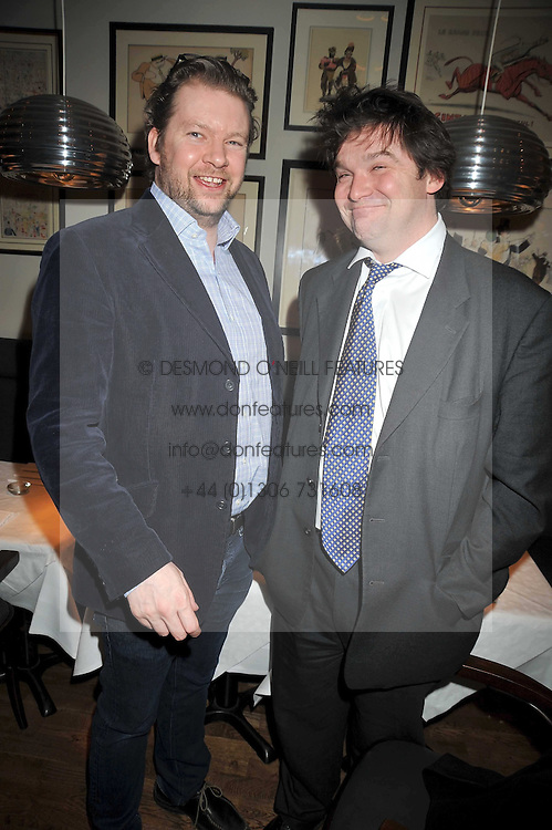 Left to right, the MARQUESS OF HAMILTON son and heir of the 5th Duke of Abercorn and VISCOUNT CRANBORNE son & heir to the 7th Marquess of Salisbur at the opening of the Brompton Bar & Grill, 243 Brompton Road, London SW3 on 11th March 2009.