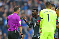 Football - 2021 / 2022 Premier League - Brighton & Hove Albion vs Leicester City - Amex Stadium - Sunday 19th September 2021<br /> <br /> Referee Mr Stuart Attwell has to explain his decision to Wilfred Ndidi of Leicester City about disallowing his goal at The Amex Stadium Brighton <br /> <br /> COLORSPORT/Shaun Boggust