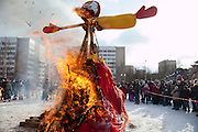 Istra, Russia, 06/03/2011..People watch a giant doll of Lady Maslenitsa burn as they celebrate Maslenitsa, also known as Butter Week or Pancake Week. Maslenitsa marks the beginning of the Russian Orthodox period of Lent, but is a traditional Russian Holiday marking the end of winter, and has its origins in pagan times.
