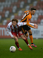 Football - 2020 / 2021 Emirates FA Cup - Round 2 - Stevenage vs Hull City - Lamex Stadium<br /> <br /> Stevenage's Arthur Read holds off the challenge from Hull City's Regan Slater.<br /> <br /> COLORSPORT/ASHLEY WESTERN