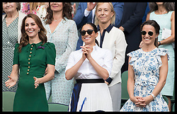 July 13, 2019 - London, London, United Kingdom - Image licensed to i-Images Picture Agency. 13/07/2019. London, United Kingdom. Kate Middleton, the Duchess of Cambridge ,Meghan Markle, the Duchess of Sussex and Pippa Middleton watch Serena Williams receive the runner up trophy after she lost  the Ladies Final on day twelve of the Wimbledon Tennis Championships in London. (Credit Image: © Stephen Lock/i-Images via ZUMA Press)