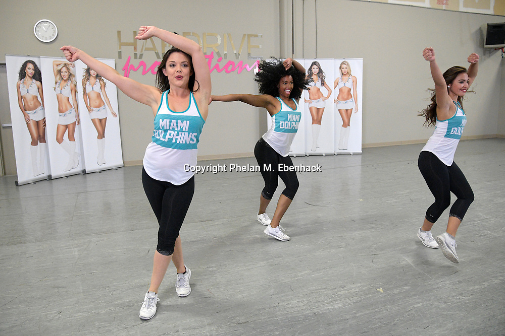 Current Miami Dolphins cheerleaders Etta, left, Jess, center, and Tamara perform during a tryout for the squad Saturday, May 6, 2017 in Orlando, Fla. The final tryout will be held in Miami in June. (Photo by Phelan M. Ebenhack)