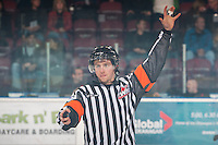 KELOWNA, CANADA - NOVEMBER 9:  Mark Pearce, referee calls for players to line up at centre ice as the Red Deer Rebels visit the Kelowna Rockets on November 9, 2012 at Prospera Place in Kelowna, British Columbia, Canada (Photo by Marissa Baecker/Shoot the Breeze) *** Local Caption ***