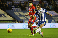 Wigan Striker Will Grigg strikes during the Sky Bet League 1 match between Wigan Athletic and Gillingham at the DW Stadium, Wigan, England on 7 January 2016. Photo by Pete Burns.