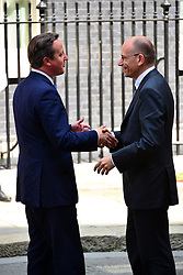 Prime Minister David Cameron (L) greets Italian Prime Minster Enrico Letta at 10 Downing Street. <br /> Mr Letta is in the UK on a two day visit.<br /> 10 Downing Street, London, United Kingdom<br /> Wednesday, 17th July 2013<br /> Picture by Nils Jorgensen / i-Images