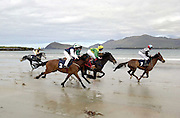 BALLYFERRITER RACES-DINGLE 5-5-02<br />Horse racing has taken place on Ballyferriter Strand in County kerry only once in the last 50 years and that was in 1972, but thousands turned out to the picturesque beach outside Dingle in County Kerry to witness the revival on Sunday. <br />Our picture shows the horses setting off in the second race with the eventual winner number 7 already in a commanding position.<br />Picture by Don MacMonagle