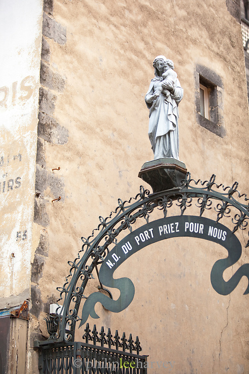 Statue of the Virgin Mary over the entrance to Notre-Dame du Port, Clermont-Ferrand, France